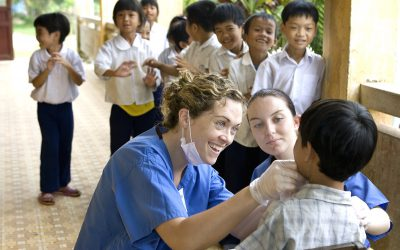 VNM_2007_Irish_Dentists_01 General Dentist, Audrey McGovern of Ireland at left and General Dentist, Laura Owens of Ireland at right during screening at an elementary school outside Hue Vietnam. The Operation Smile Comprehensive Care Center in Hue, Vietnam, based in the Hue Odonto-Stomatological Hospital And 3 dental vans visiting schools for treatment of the students. (Operation Smile Photo - Marc Ascher) Operation Smile Dental Mission in Hanoi and Hue Vietnam. March 22-April 1, 2007